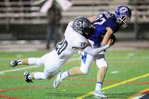 Darien overpowers Staples in Class LL - Photo