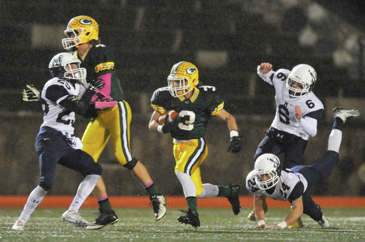 Trinity Catholic running back Jonmichael Bivona finds room to run against Morgan School on Tuesday, Dec. 1, 2015.