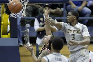 Cal's Tyrone Wallace works on vocal leadership from bench - Photo