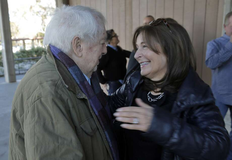 Janice Lazzara Toben, right, hugs George Ward before former students of the Woodside High School drama teacher gathered at Gunn High School in Palo Alto, Calif., to fete the beloved teacher on Sunday, November 29, 2015. The event was performed as a mock tryout by those students who flew in from all over the country. Photo: Carlos Avila Gonzalez, The Chronicle