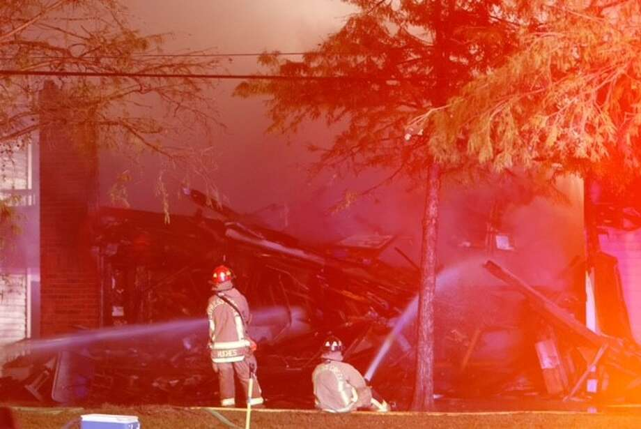 Fire crews battled an early-morning apartment fire on Park Point Drive. Several people were injured and taken to the hospital. The cause of the fire is under investigation. Dec. 2, 2015 Photo: Metro Video