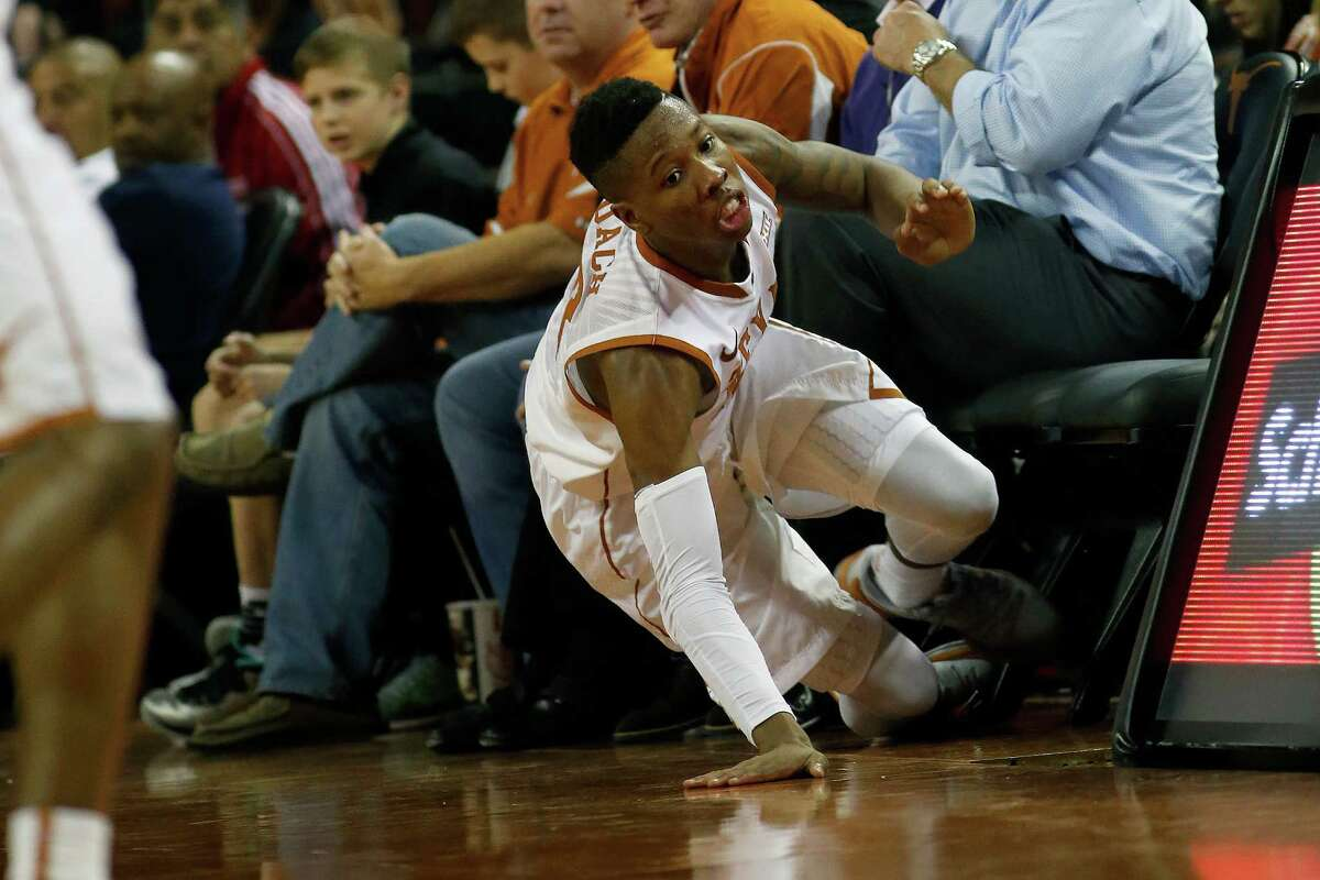 AUSTIN, TX - DECEMBER 1: Kerwin Roach Jr. #12 of the Texas Longhorns slides out of bounds after going for a loose ball against the Texas-Arlington Mavericks at the Frank Erwin Center on December 1, 2015 in Austin, Texas.