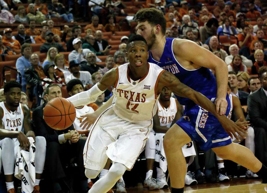 AUSTIN, TX - DECEMBER 1: Kerwin Roach Jr. #12 of the Texas Longhorns drives around Nick Pallas #30 of the Texas-Arlington Mavericks at the Frank Erwin Center on December 1, 2015 in Austin, Texas. Photo: Chris Covatta, Getty Images / 2015 Chris Covatta
