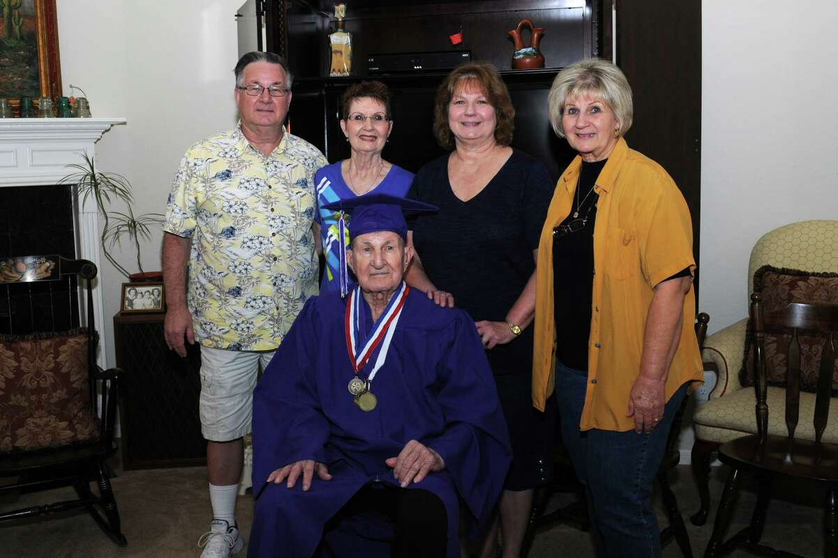 Military veteran John Kressley was surprised on his 91st birthday with a diploma stating he graduated from Jefferson Davis High School in 1942. Kressley left school after his junior year to work and later join the armed forces. Children John Kressley, Jr., left, Judy Smith, Debbie Fourman and Cheryl Simpson helped Kressley celebrate his special day.