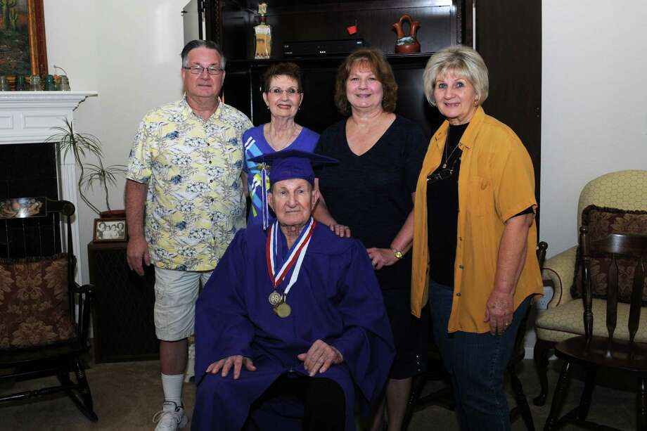 Military veteran John Kressley was surprised on his 91st birthday with a diploma stating he graduated from Jefferson Davis High School in 1942. Kressley left school after his junior year to work and later join the armed forces. Children John Kressley, Jr., left, Judy Smith, Debbie Fourman and Cheryl Simpson helped Kressley celebrate his special day. Photo: George Wong / Freelance