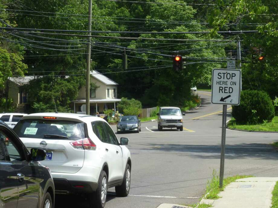 The town is hiring Cabezas DeAngelis Engineers to redesign the intersection of Locust Avenue and Brushy Ridge Road with state-maintained Route 123 for a project to improve pedestrian safety. Photo: Martin Cassidy / Hearst Connecticut Media / New Canaan News