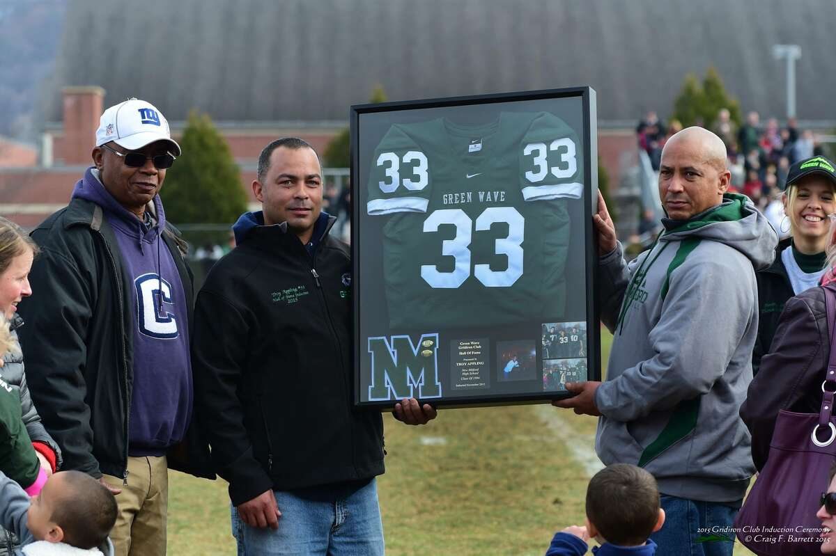 From left, Mike Appling with his sons, Troy and Mike during halftime of the Candlewood Cup on Thanksgiving. Troy Appling, a 1994 New Milford High School grad, was the first to be inducted into the Green Wave Gridiron Club's Hall of Fame.