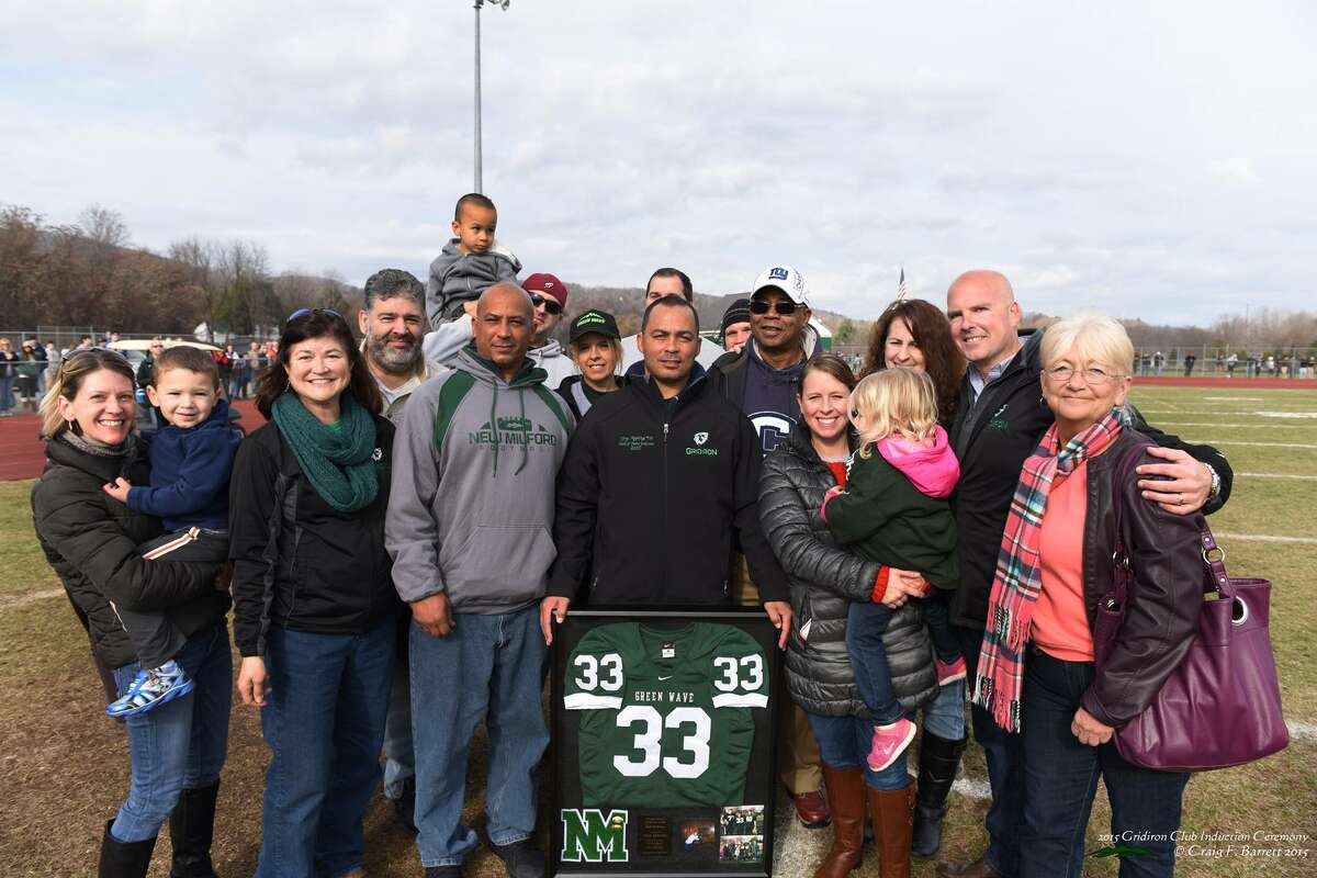 Troy Appling, center a 1994 New Milford High School grad, was the first to be inducted into the Green Wave Gridiron Club's Hall of Fame during halftime of the Candlewood Cup on Thanksgiving.