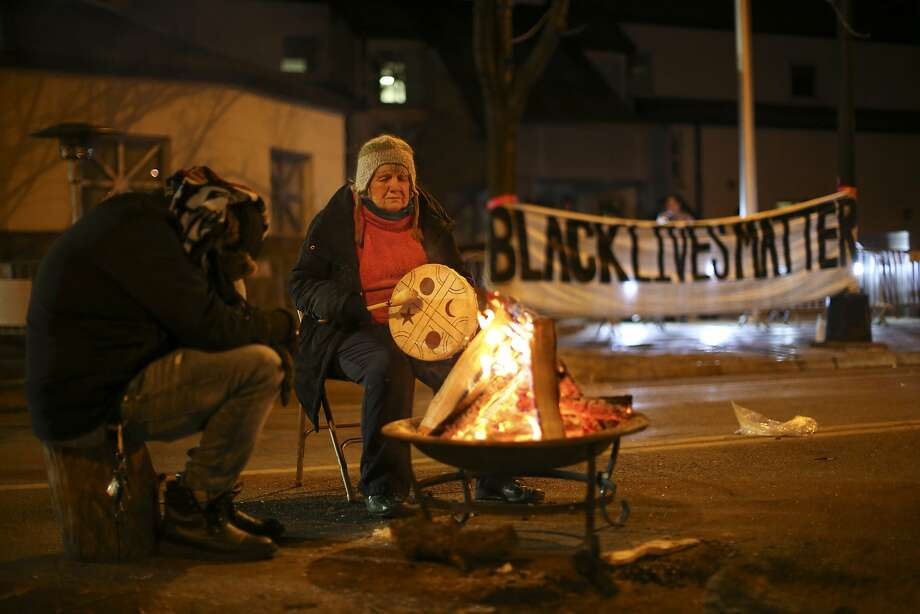 People warm themselves during protests last month in Minneapolis following the fatal shooting of Jamar Clark. Photo: Jeff Wheeler, Associated Press