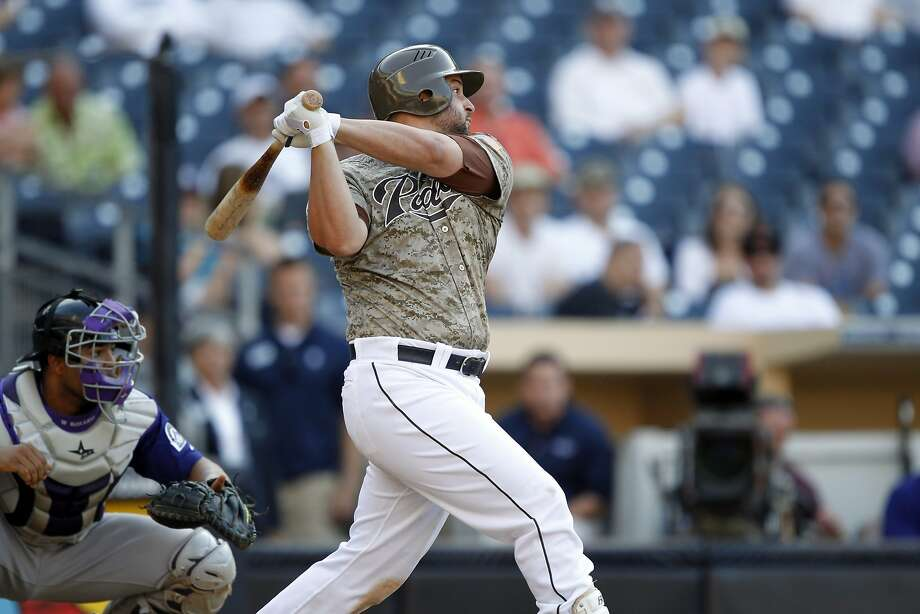 The San Diego Padres have traded first baseman Yonder Alonso and  reliever Marc Rzepczynski to the Oakland A's for left-hander Drew  Pomeranz and minor league pitcher Jose Torres, plus either a player to  be named or cash. Photo: Alex Gallardo, Associated Press