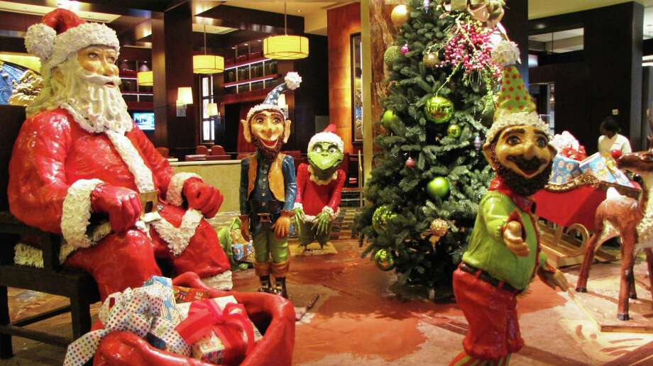 A holiday chocolate display made from more than 1.5 million tons of chocolate (and an estimated 7.6 million calories) is on display at the Hilton-Americans in Houston throughout the 2015 holiday season. Photo: Hilton-Americas