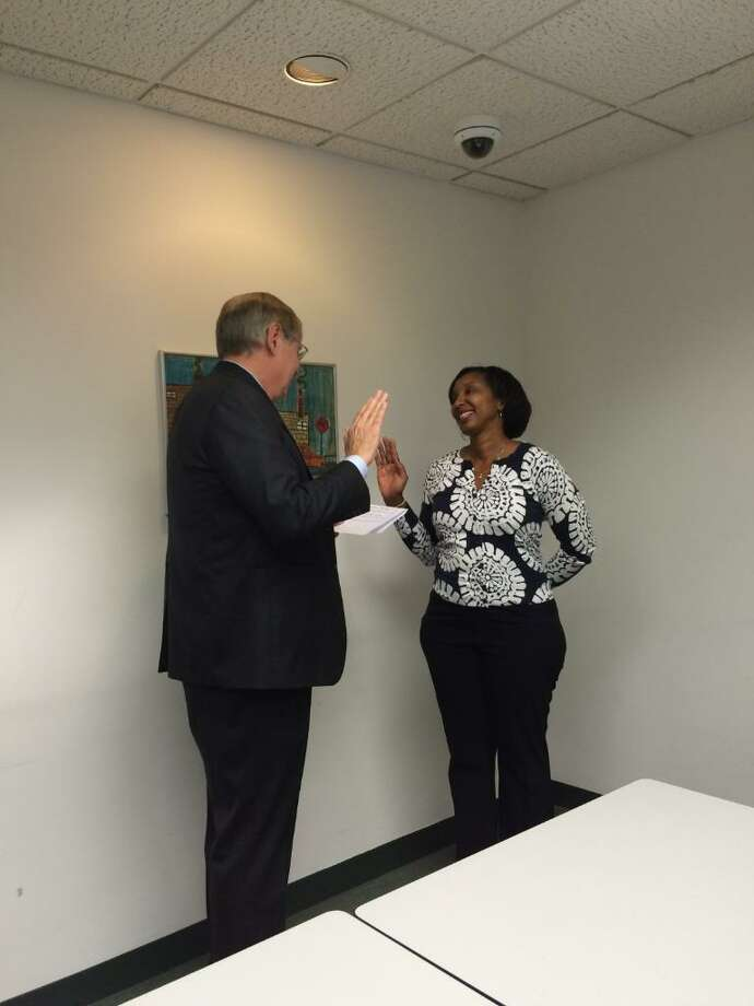 Board of Education member Jennienne Burke takes the oath of her office Tuesday night. Mayor David Martin swore her in during a brief private ceremony while a joint session of the Board of Finance, Board of Representatives, and the Planning Board met. Photo: Contributed Photo / Stamford Advocate Contributed