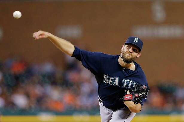 DETROIT, MI - JULY 21: Tom Wilhelmsen #54 of the Seattle Mariners pitches in the seventh inning of the game against the Detroit Tigers on July 21, 2015 at Comerica Park in Detroit, Michigan. The Mariners defeated the Tigers 11-9.