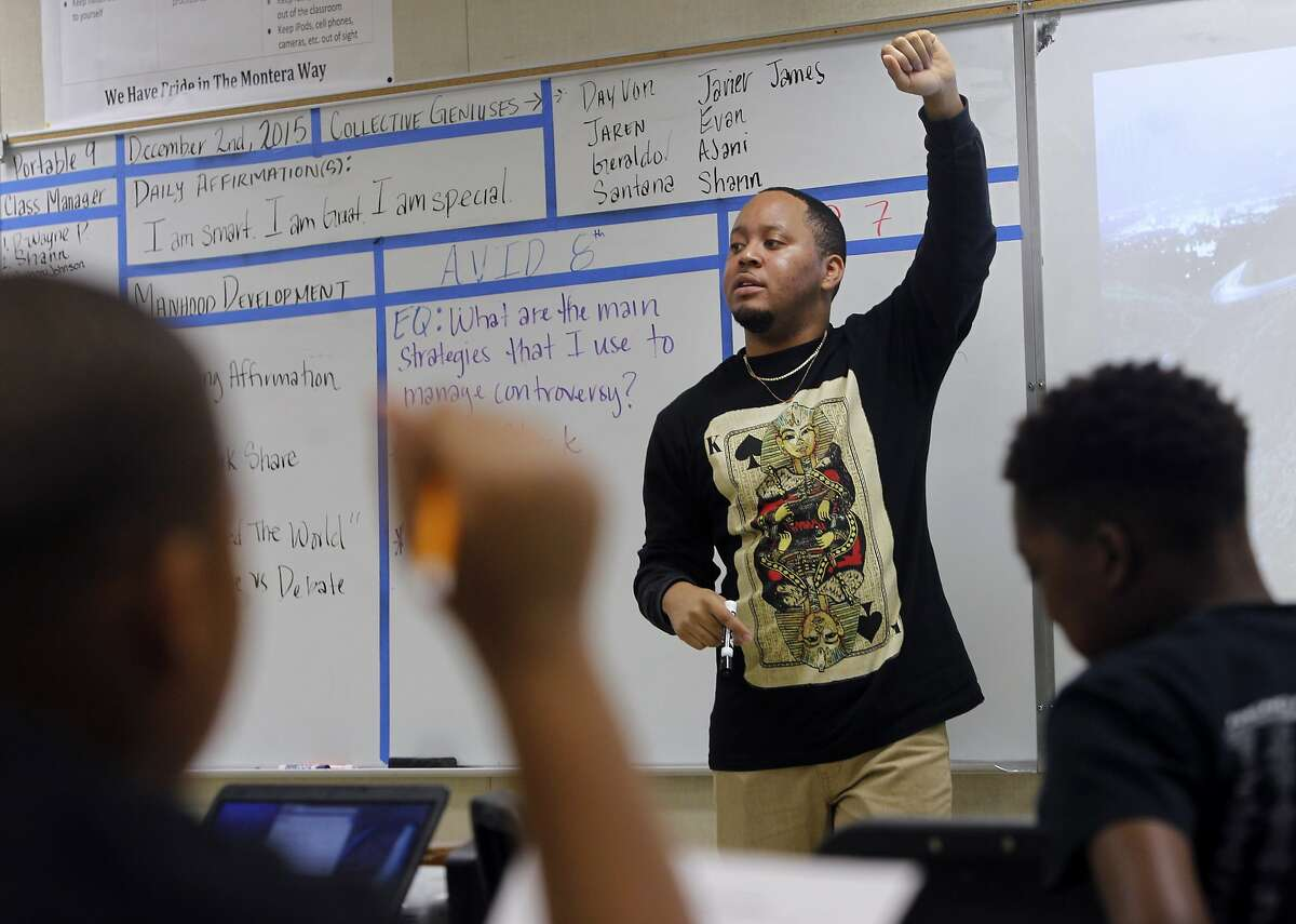 Kevin Jennings teaches the Manhood Development class for 6th grade boys at Montera Middle School in Oakland, Calif. on Wednesday, Dec. 2, 2015.