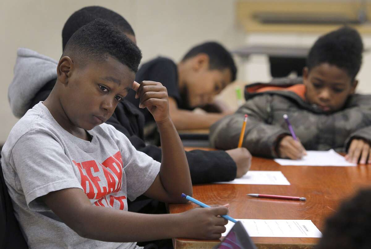 Jaren Taylor puts some thought into a classroom exercise in a Manhood Development class for 6th grade boys at Montera Middle School in Oakland, Calif. on Wednesday, Dec. 2, 2015.