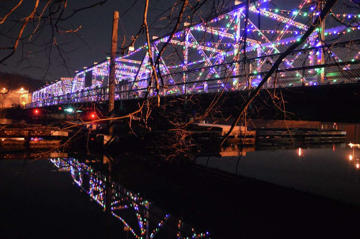 Decked for the holidays with twinkling lights, the historic Bridge Street bridge -- formally, the William F. Cribari Bridge -- glows above the Saugatuck River. The holiday lights are maintained by the non-profit, Al's Angels.