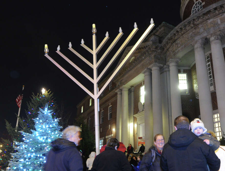 A photo from the 2014, Chabad of Greenwich Menorah lighting ceremony on the first night of Hanukkah at the YMCA of Greenwich. The menorah will be lit for the first night on Dec. 6 and Chabad is beginning a toy drive that night too. Photo: Bob Luckey / Bob Luckey / Greenwich Time