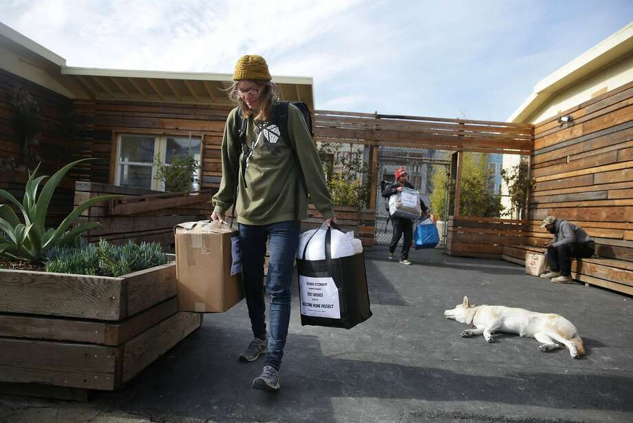 Barbara McHenry (left), who moved to her new room on November 4, after living at the Navigation Center for 2 months, collects some of the last of her belongings from the Navigation Center with her partner Bernard Thomas O'Connor Jr.(second from left), who also got a room,  on Wednesday, December 2,  2015 in San Francisco, Calif. Photo: Lea Suzuki, The Chronicle