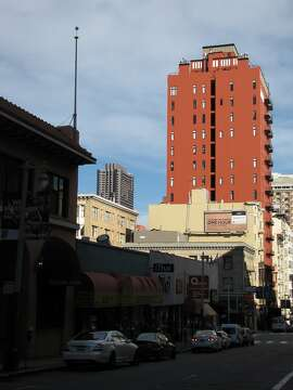 The 17-story residential tower at 666 Pine St. on the slope of Nob Hill is taller than anything on the block -- but the 1926 shaft stands out even more because of a rich coat of brick-red paint.