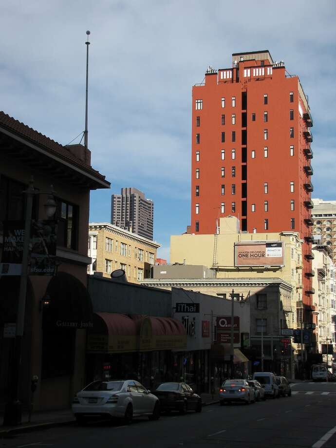 The 17-story residential tower at 666 Pine St. on the slope of Nob Hill is taller than anything on the block -- but the 1926 shaft stands out even more because of a rich coat of brick-red paint. Photo: John King, The Chronicle