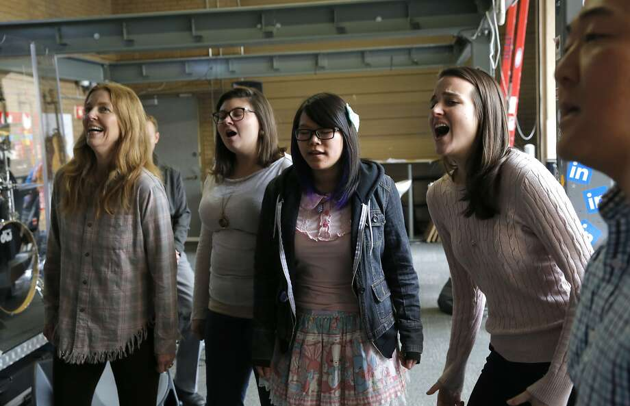 (l to r) Stefani Grothe, Mary Makarian, Christina Wong and Catherine Rieflin are members of the a cappella group TuneIn is made up of employees from LinkedIn they go through a practice session on Wed. December 2, 2015, in Mountain View, Calif., in preparation for the upcoming Techapella event. Photo: Michael Macor, The Chronicle