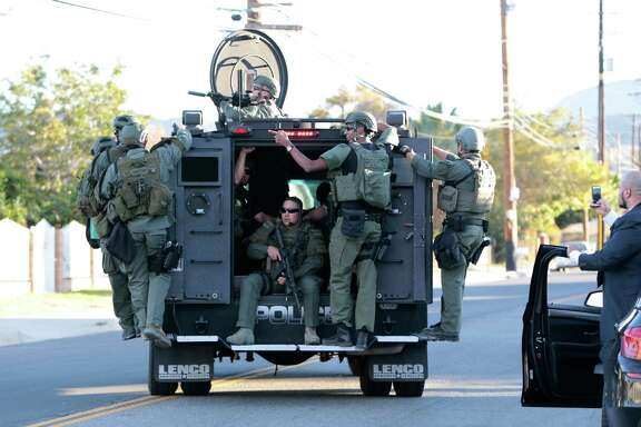 Law enforcement officers in an armored vehicle on the streets of San Bernardino, Calif., where police mounted an intense manhunt after gunmen left at least 14 dead at a conference hall where county employees had gathered, Dec. 2, 2015. Hours later, officers engaged in a shootout with at least one suspect at another location, according to the police.
