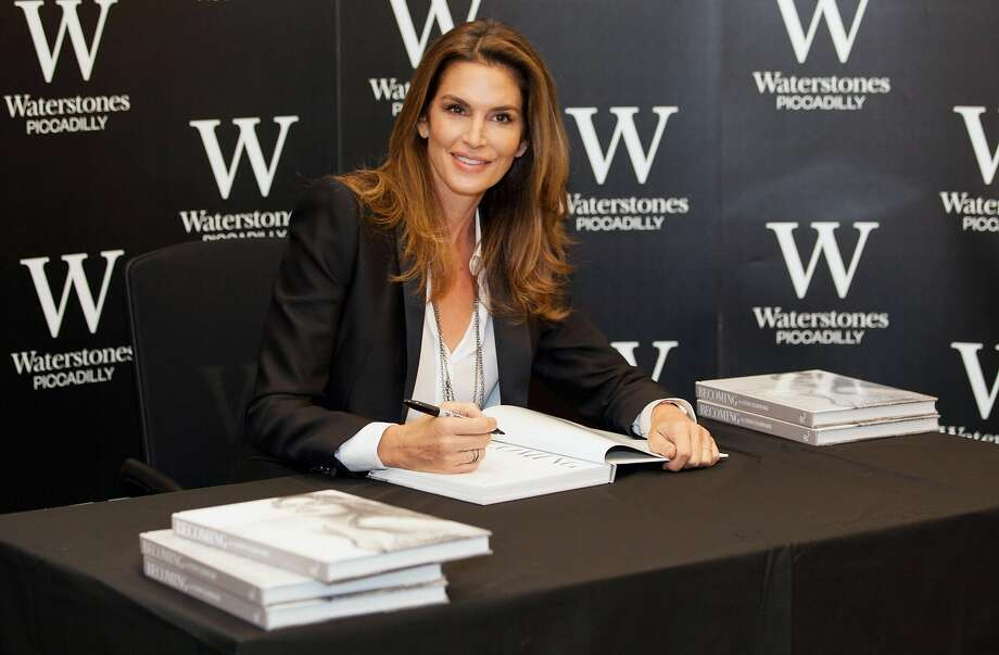 Cindy Crawford poses for photographers at the launch of her new book 'Becoming' in central London on Friday, Oct. 2, 2015. (Photo by Grant Pollard/Invision/AP) Photo: Grant Pollard, Associated Press