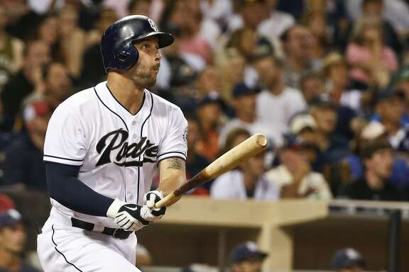FILE - In this Aug. 17, 2015, file photo, San Diego Padres' Yonder Alonso watches his solo home run against the Atlanta Braves in the eighth inning of a baseball game, in San Diego. A person with knowledge of the deal says the San Diego Padres have traded first baseman Yonder Alonso and reliever Marc Rzepczynski to the Oakland A's for left-hander Drew Pomeranz and minor league pitcher Jose Torres, plus either a player to be named or cash. The person spoke with The Associated Press on Wednesday, Dec. 2, 2015,  on condition of anonymity because the trade hadn't been announced.(AP Photo/Lenny Ignelzi, File)