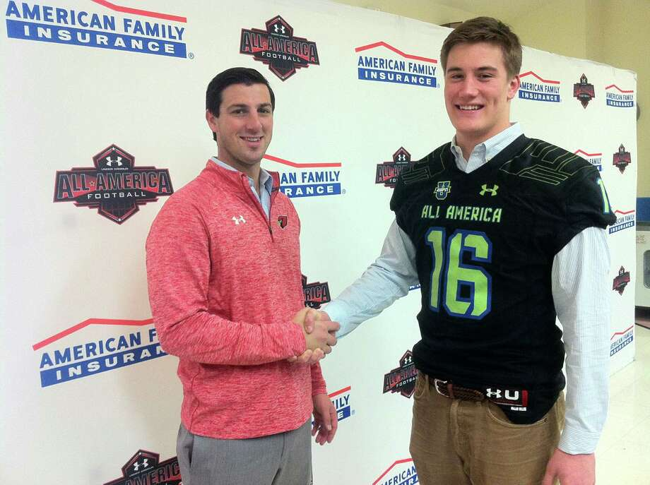 Greenwich High School senior Scooter Harrington, right, and Cardinals coach John Marinelli, shake hands following Wednesdayís press conference, which announced Harringtonís selection to the 2016 Under Armour All-America High School Football Game. The press conference was held at Greenwich High School. Photo: Contributed / Contributed Photo / Connecticut Post Contributed
