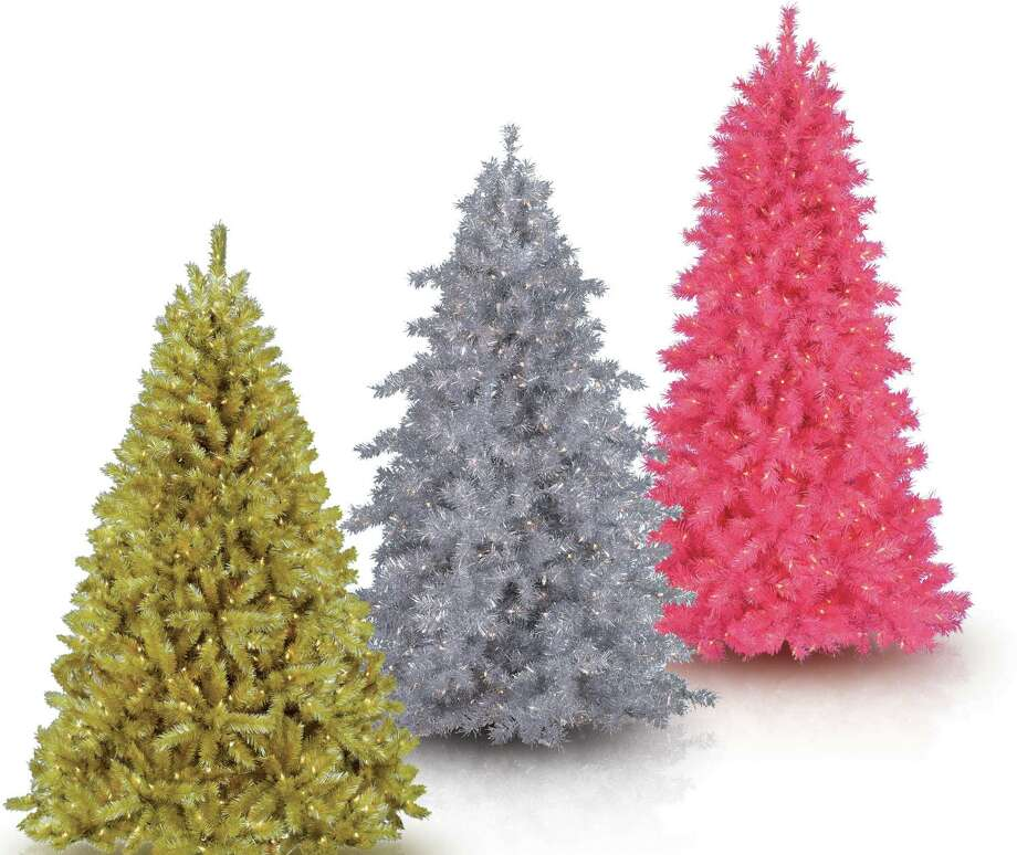 Sparkling trees are a hot Christmas tree trend this season because metallics add glitz and whimsy to the holidays. Left to right, Treetopia's toasted champagne tinsel tree, Tinkerbell silver Christmas tree and pink shimmer tree. Photo: Courtesy Treetopia