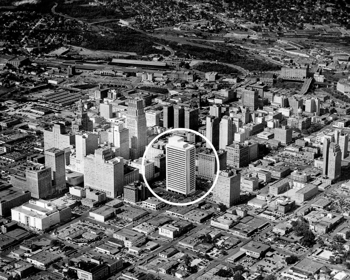 10/22/1950 - By trick photography, the 21-story Melrose Building, now under construction at Walker and San Jacinto, is shown here in relation to other downtown Houston skyscrapers. Joseph Demic, aerial photographer, first took an air shot, then photographed a model of the building at the proper angle and superimposed it on the airplane view of the skyscrapers. The structure is due to be completed by September 1, 1951 Owners are Melrose Building, Inc. owned by Melvin A. Silverman of Houston and Bennett Rose of New York. Banks Realty Associates are rental agents.
