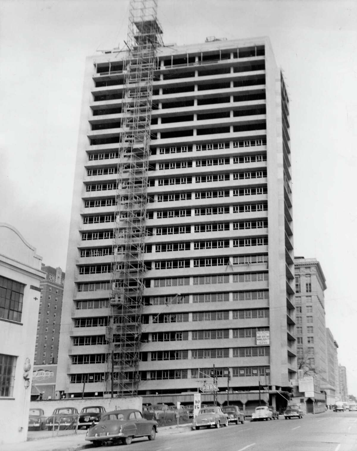 12/1951 - This unconventional skycraper, which at a distance will be silvery in tone, is the nearly completed Melrose Building, being built by Melvin A. Silverman, developer, and his New York associate, Bennett Rose. Tellepsen Construction Company is the contractor. The cost is more than $4,000,000 and completion is scheduled for February.