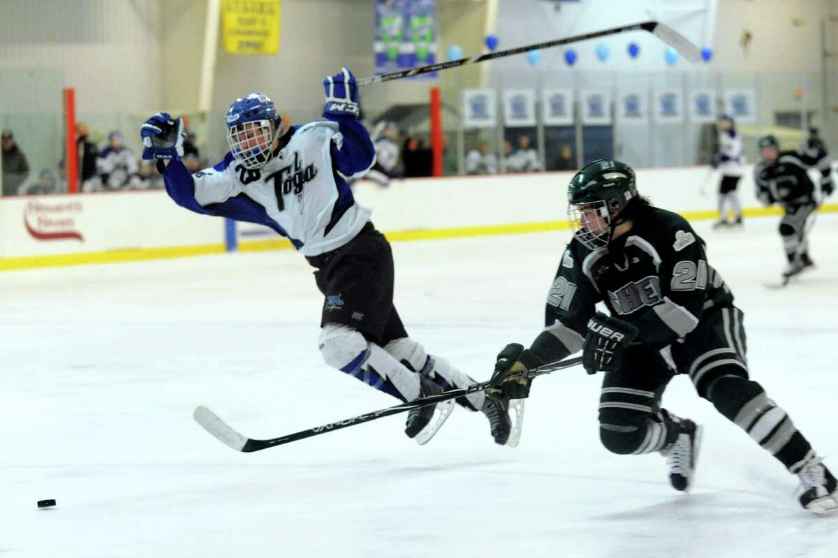 Saratoga's Elliott Hungerford, left, gets tripped up as he and Shenendehowa's Tanner Cretti chase a loose puck during their hockey game on Thursday, Feb. 6, 2014, at Saratoga Ice Rink in Saratoga Springs, N.Y. (Cindy Schultz / Times Union)