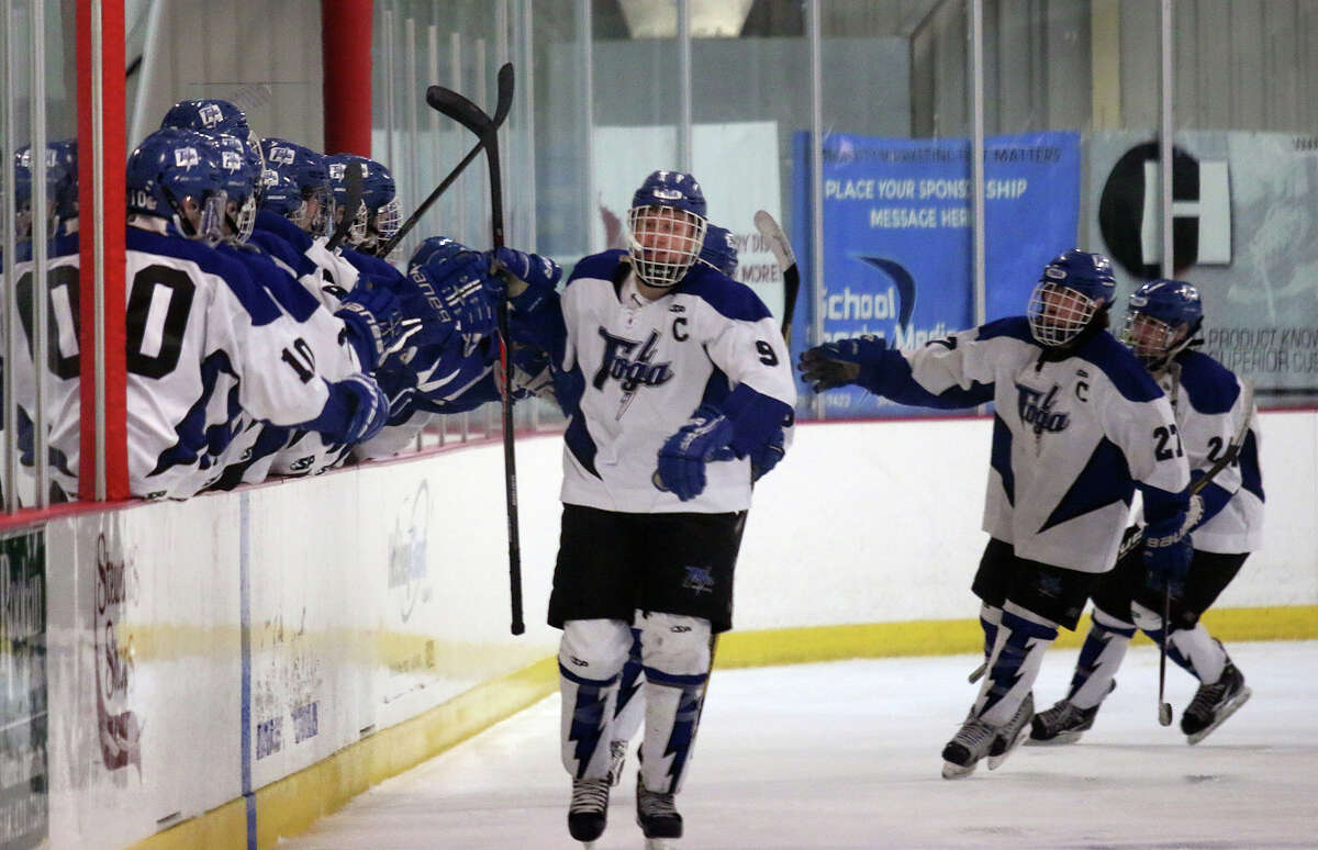 Saratoga's Elliott Hungerford (9) receives a warm welcome at the Blue Streak bench after his 2nd period goal over Bethlehem during Friday's Section II hockey semifinal February 20, 2015 at Saratoga Springs Ice Rink. (Ed Burke / Special to the Times Union)