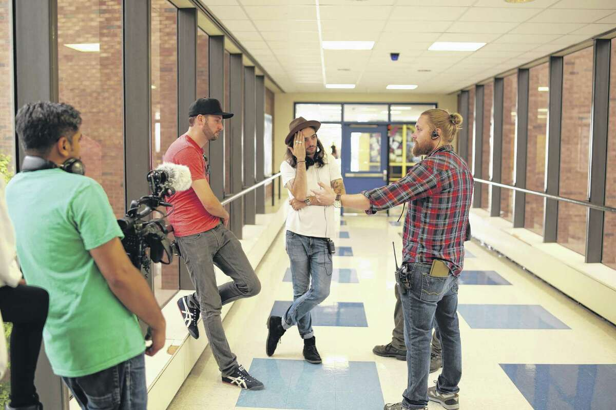 (L to R) Brent Stiefel (producer), Miles Joris-Peyrafitte (Director), Sean Patrick Burke (1st AD/Producer), Bhawin Suchak (in foreground). Discussing a complex dolly shot in the hallway of Albany High School. (Photo courtesy Youth FX) ORG XMIT: MER2015100215230838