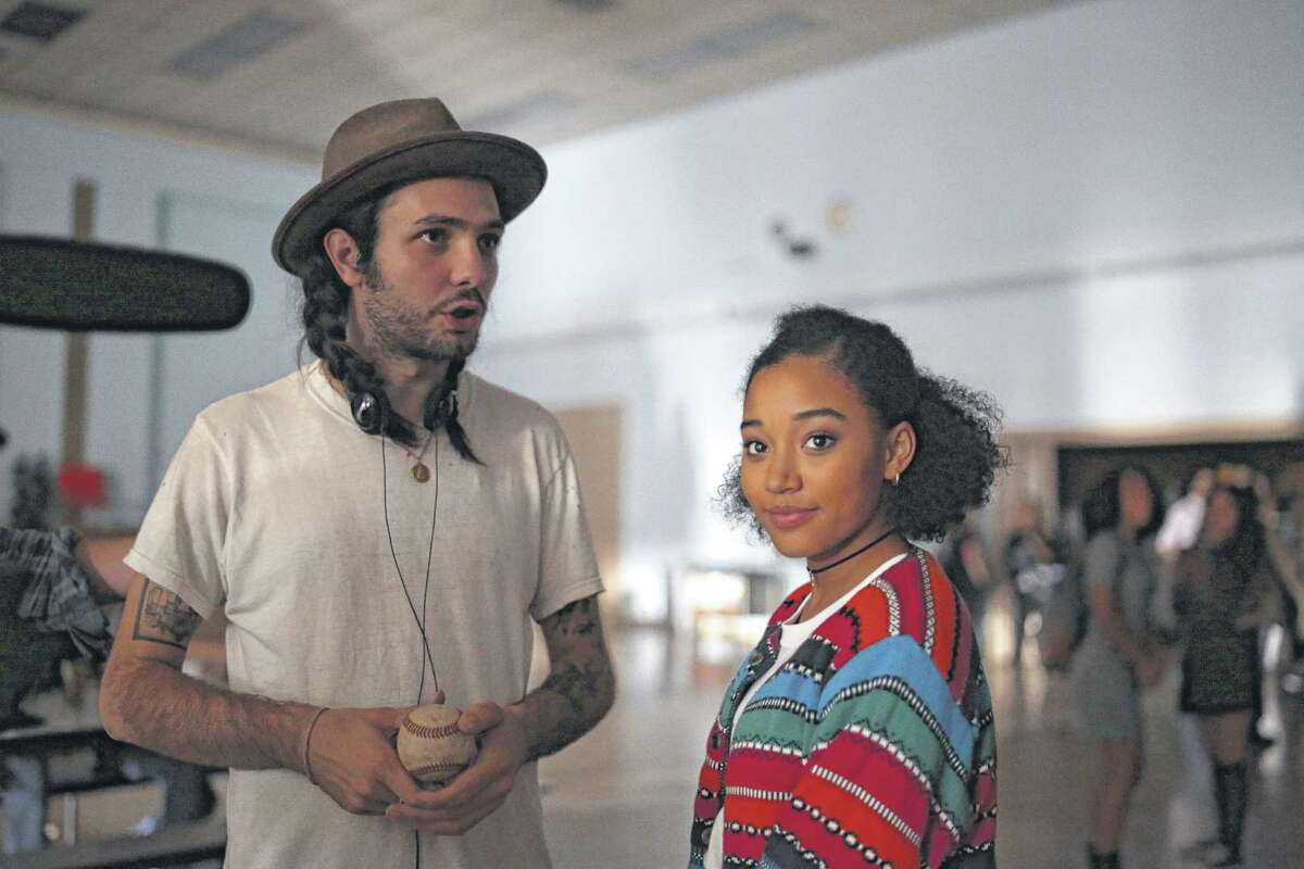 Miles Joris-Peyrafitte (Director) and Amandla Stenberg (Lead Actor - Sarah) discussing a scene at the former Bishop Maginn High School. (Photo courtesy Youth FX) ORG XMIT: MER2015100215245447