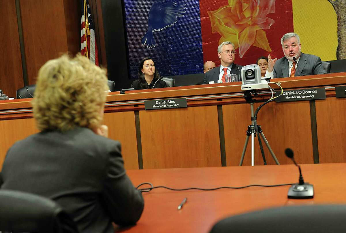 Karen Murtagh, left, listens to a question from assemblyman Daniel O'Donnell as the Assembly Corrections Committee holds a hearing on oversight and investigations of the Department of Corrections at the Legislative Office Building on Wednesday Dec. 2, 2015 in Albany, N.Y. (Lori Van Buren / Times Union)