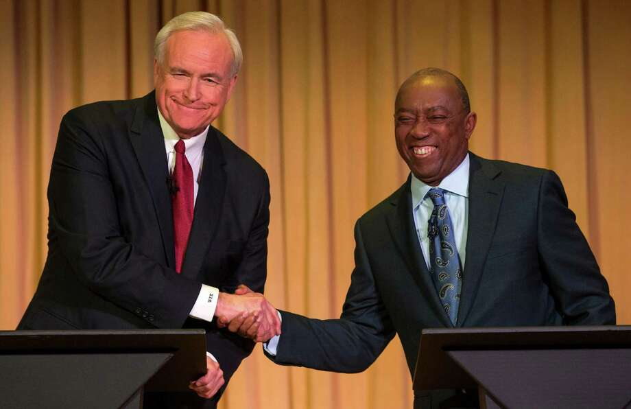 Mayoral candidates Bill King, left, and Sylvester Turner face off in a mayoral debate at the University of Houston-Downtown on Wednesday, Dec. 2, 2015, in Houston. King and Turner  are in a runoff election for mayor. Photo: Brett Coomer, Houston Chronicle / © 2015 Houston Chronicle