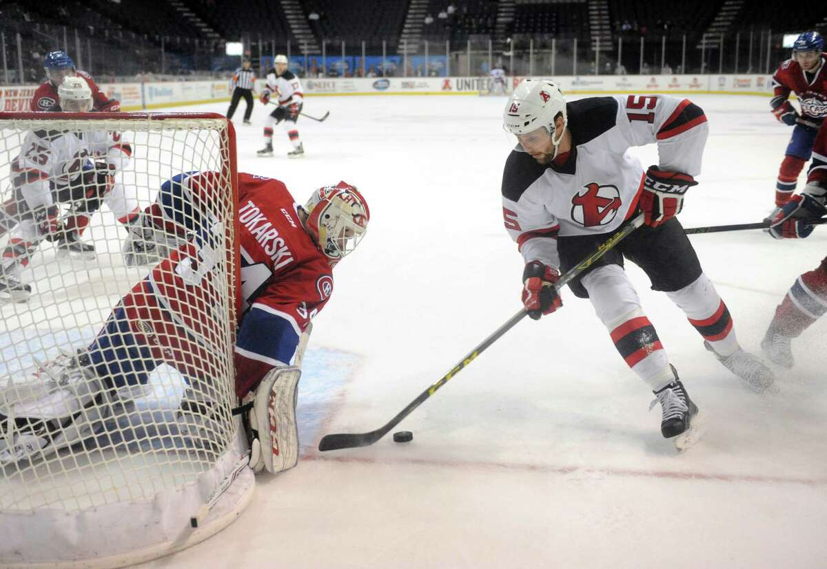 Devils Paul Thompson closes in on St. John's goalie Dustin Tokarski during their hockey game at the Times Union Center on Wedesday Dec. 2, 2015 in Albany, N.Y. (Michael P. Farrell/Times Union)