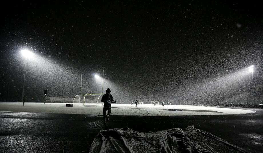 A player runs onto the field for Lacrosse practice at Zionsville High School as snow falls, Wednesday, Dec. 2, 2015, in Zionsville, Ind.  Photo: Darron Cummings, Associated Press