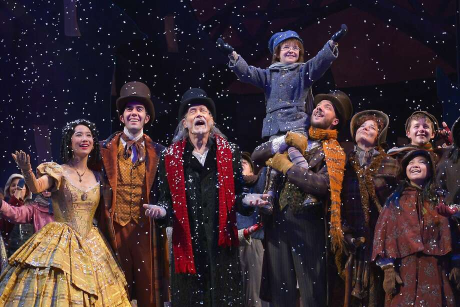 "James Carpenter (center with red scarf) as the redeemed  Ebenezer Scrooge in ACT's ""A Christmas Carol."" Photo: Kevin Berne"