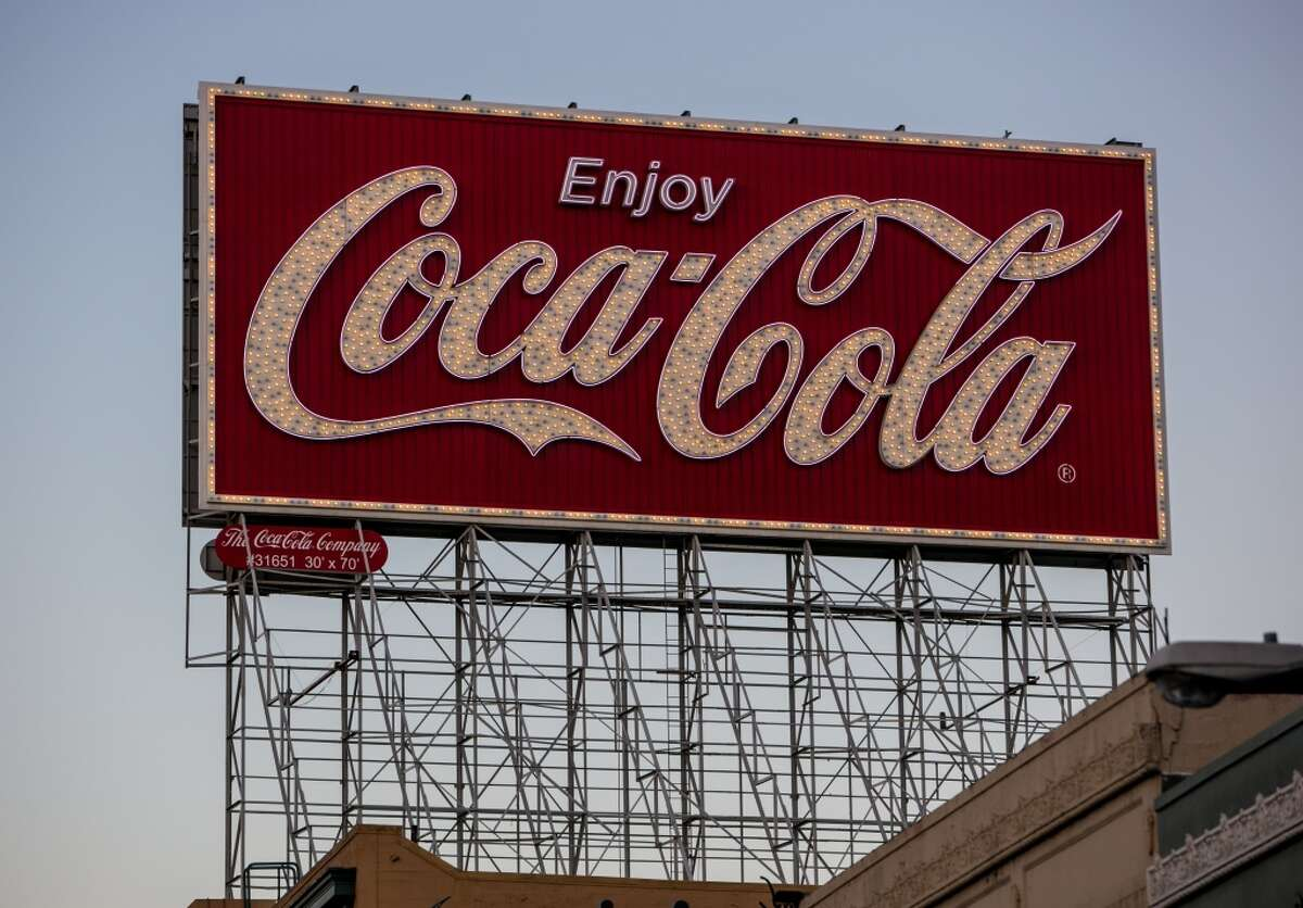 The towering Coca-Cola billboard is shown at the downtown connector of Interstate 80 and Highway 101 to the Bay Bridge in this Sept. 20, 2013, file photo. San Francisco has issued a work permit for removal of the landmark, which has greeted drivers since 1937.
