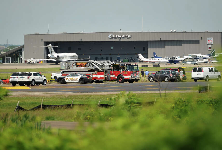 Emergency workers on the scene of a fatal construction accident at Sikorsky Airport in Stratford, Conn. on June 25, 2015. In 2014 in Connecticut, 33 people lost their lives on the job, up from 29 deaths in 2013. Photo: Brian A. Pounds / Hearst Connecticut Media / Connecticut Post