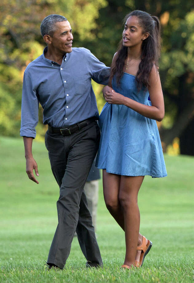 In this photo taken Aug. 23, 2015, President Barack Obama and his daughter Malia walk across the South Lawn of the White House in Washington from Marine One. The 17-year-old is among the millions of U.S. high school seniors who are nervously taking standardized tests, completing college admissions applications, filling out financial aid forms and writing personal essays, all on deadline, before spending the coming months anxiously waiting to find out if they got into their dream school. (AP Photo/Carolyn Kaster) Photo: Carolyn Kaster, STF / AP