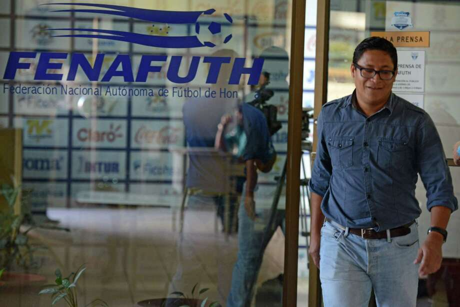 Journalists arrive to the Honduran National Football Federation (FENAFUTH) headquarters in Tegucigalpa on December 3, 2015. Six months after a first wave of arrests of leading football executives that sparked the beginning of a huge corruption scandal at FIFA, its vice-president and CONCACAF interim president, Honduran Alfredo Hawit, was arrested in Zurich Thursday alongside Conmebol's president, Paraguayan Juan Angel Napout, at the request of the United States.  AFP PHOTO / Orlando SIERRAORLANDO SIERRA/AFP/Getty Images Photo: ORLANDO SIERRA, AFP / Getty Images / AFP