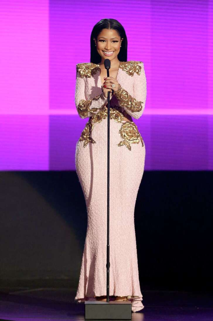 FILE - In this Nov. 22, 2015 file photo, Nicki Minaj wears a pink gown as she presents the award for favorite duo or group - pop/rock at the American Music Awards in Los Angeles. The experts at the Pantone Color Institute have chosen two colors of the year, Rose Quartz, a pale pink and Serenity, a shade that is closer to baby blue.  (Photo by Matt Sayles/Invision/AP, File)