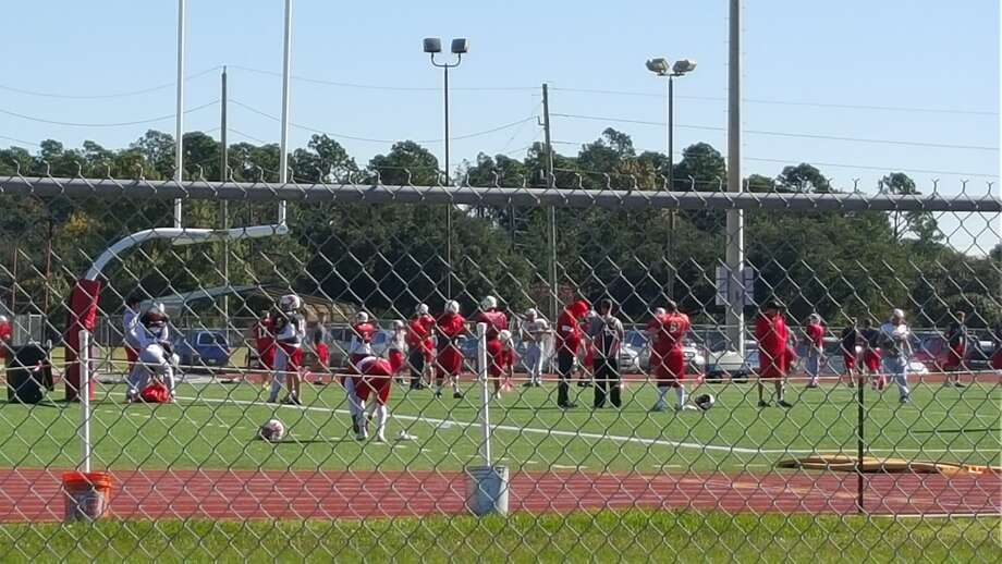 Katy players go through their morning practice after the team was cleared to remain in the playoffs. (Corey Roepken / For the Chronicle)