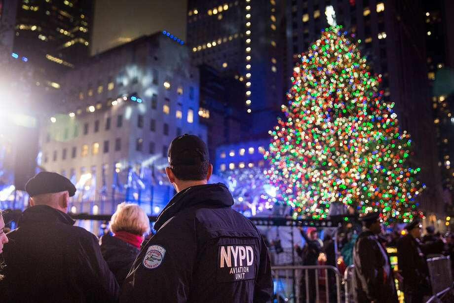 Police officers stand guard at the Rockefeller Center complex during the annual lighting of the Rockefeller Center Tree on December 2, 2015 in New York City. Tonight's ceremony, which included performances by Sting, Mary J. Blige and Michael Buble, marks the 83rd annual Rockefeller Center Tree lighting. Photo: Andrew Burton, Getty Images