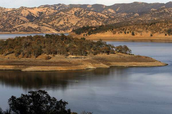 The low water level of Lake Berryessa, Calif., as seen across Spanish Flat on Tuesday December 1, 2015. The town of Monticello, Ca. is just one of at least 30 Gold Rush-era towns that emerged into ghostly view by the dropping levels of reservoirs around the state from the California drought.