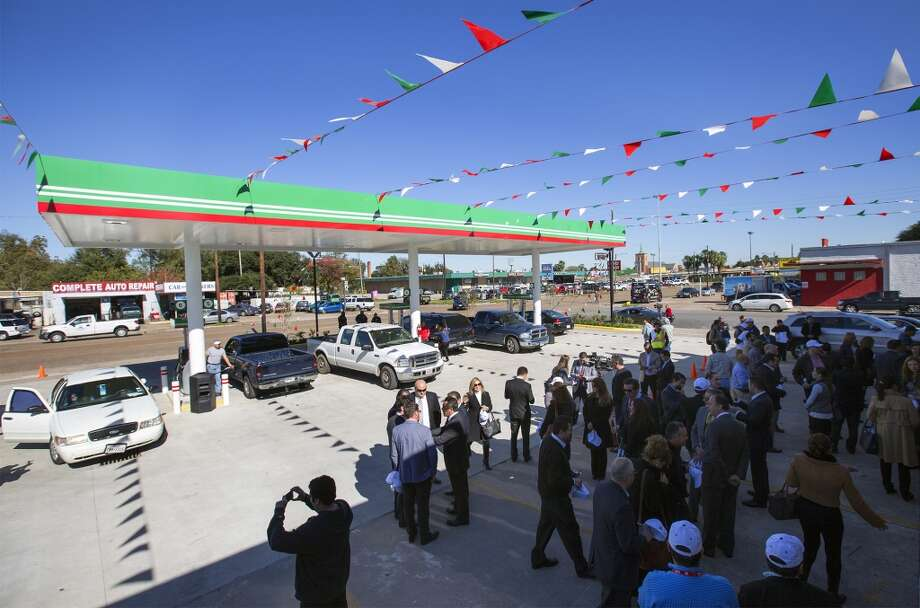 Guests attend the grand opening of PEMEX in the 7900 block of Park Place Blvd, Thursday, Dec. 3, 2015, in Houston. The national energy company of Mexico, Pemex, is launching its brand in the U.S. with retail gasoline stations, starting in Houston. (Cody Duty / Houston Chronicle) Photo: Houston Chronicle